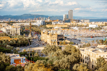 Top view on Barcelona city with Columbus monument, beautiful buildings and harbor in Spain