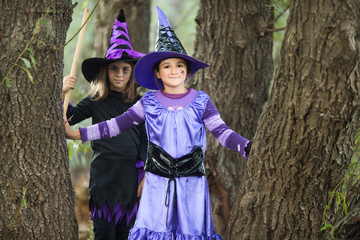 Two little witches in the forest