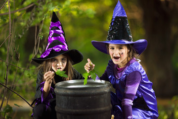 Two little witches cooking