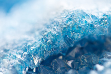 Winter cold background, blue crystals. Macro