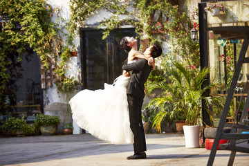 asian bride and groom celebrating wedding