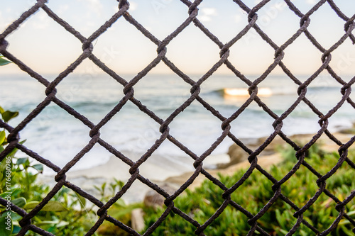 A rusty chain link fence guards the san diego california