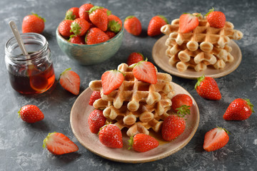 Waffles with maple syrup and strawberries