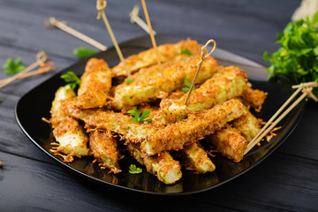 Zucchini slices baked under cheese breading