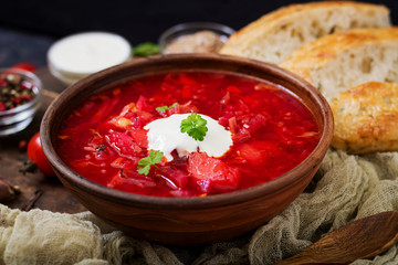 Traditional Ukrainian Russian borscht with white beans on the  bowl.
