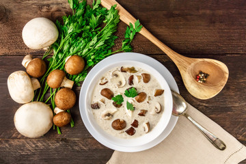 Plate of mushroom soup with champignons, cremini, and parsley