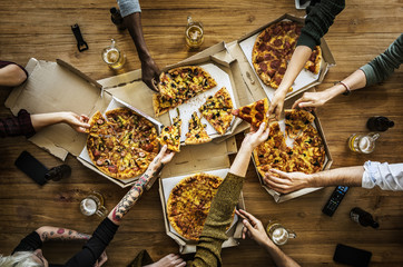 People having a pizza party