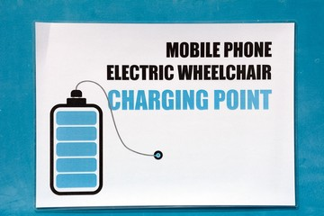 Mobile phone charging point sign in the harbour, Birzebugga, Malta.