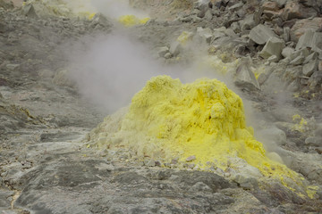 Yellow fumaroles on the volcanic Mount Io, Hokkaido, Japan