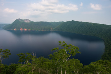 Mount Kamui and the beautiful clear blue Lake Mashu, Hokkaido, Japan