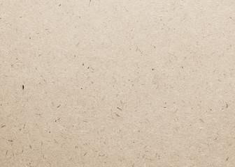 Beige particle pressed wood panel of oriented strand board (OSB) texture background in light brown cream sepia color .