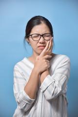 Woman feeling toothache.