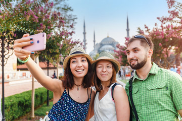 Group of multiracial friends making selfie in Istanbul, travel and vacation for students in Turkey concept