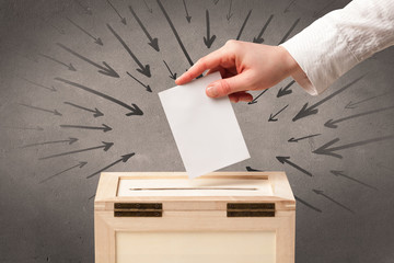 close up of a ballot box and casting vote