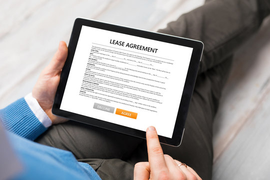 Man reading lease agreement.