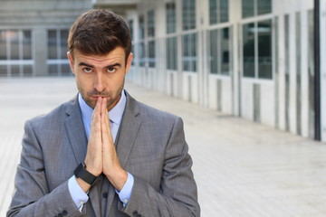 Businessman praying in the office