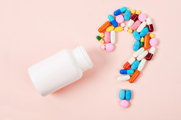 Pills or capsules as a question mark.