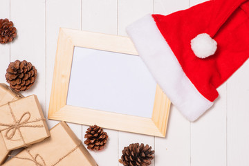 Christmas presents in decorative boxes on white wooden table background