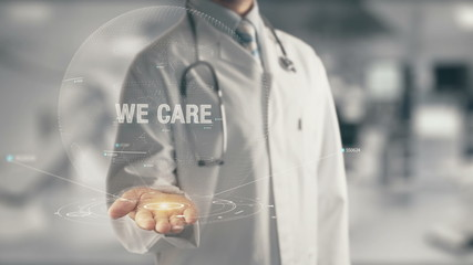 Doctor holding in hand We Care