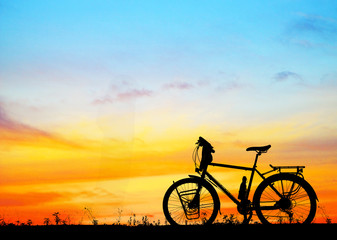 silhouette vintage bike on blurry  sunrise background
