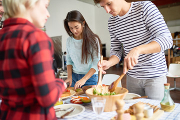 Friends preparing dinner together