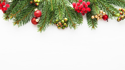 Christmas background with xmas tree and red berries on white wooden background. Merry christmas greeting card, frame, banner. Winter holiday theme. Happy New Year.