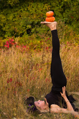 Ordinary woman in witch costume practicing yoga