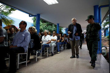 Venezuela's citizens wait to cast their votes on a polling station during a nationwide election for new governors in Caracas