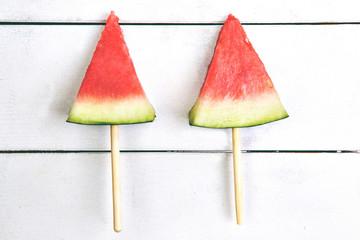 fresh watermelon slices top view wooden background