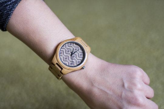 wooden watch on female hand