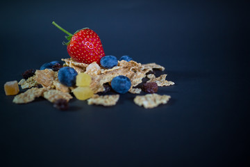 whole grain cereal flakes which mixed berry fruit and raisins