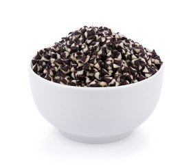 Chocolate chip morsels spread in bowl on white