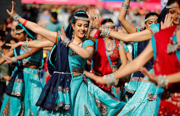 Dancers perform a traditional Indian dance during the Diwali festival of light celebrations, in Trafalgar Square, central London