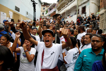 Opposition supporters shout slogans during a nationwide election for new governors in Caracas