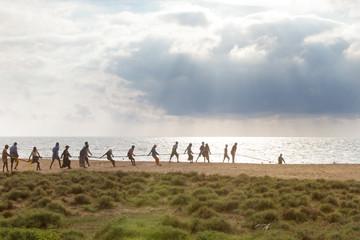Teamwork at Thoduwawa Beach, Sri Lanka
