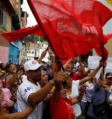 Pro-government supporters shout slogans during a nationwide election for new governors in Caracas