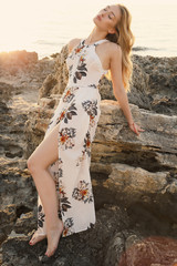 beautiful girl with blond hair in elegant clothes posing at summer  beach