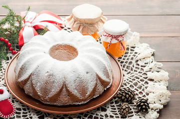 traditional decorated christmas cake at wooden table