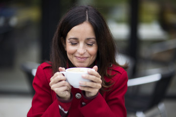 young woman enjoying coffee