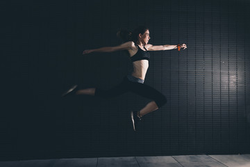 Flexible woman jumping