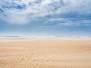 Cloudy sky over the sandy beach