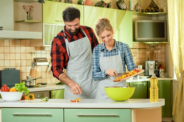 People in the kitchen, vegetables. Couple preparing food. Recipes to cook together.