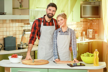 Man and woman smiling, kitchen. Happy caucasian couple.