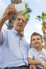 Grandfather and grandson taking a selfie
