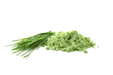 Wheat grass powder and sprouts, isolated on white