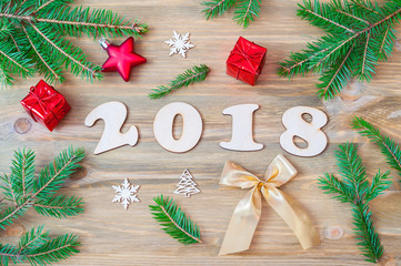 New Year 2018 background with 2018 figures,Christmas toys, fir branches-New Year 2018 holiday still life