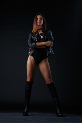 Photo of girl with boots, underwear and leather jacket
