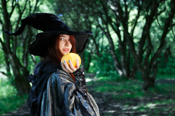 Picture of witch with pumpkin in hand