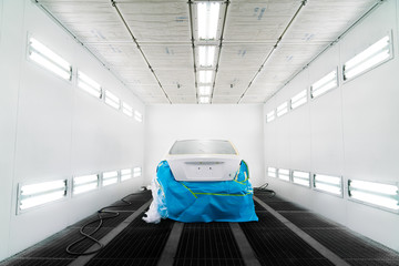 White car in paint booth