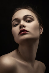happy luxury woman model with professional makeup on black background